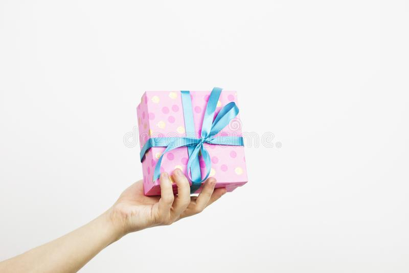 Hand holding coloured present box isolated,copy space. Hand holding coloured present box isolated , copy space royalty free stock images