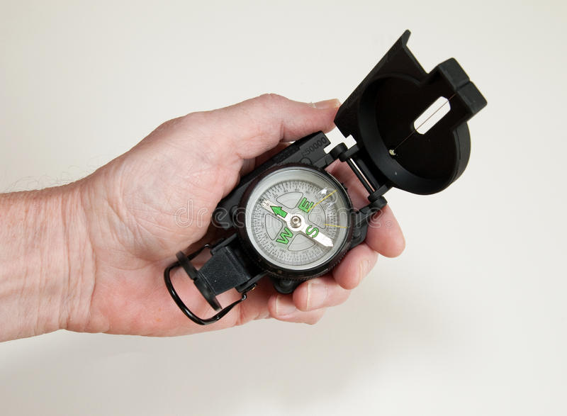 Download Hand Holding Compass stock photo. Image of navigation - 12055864