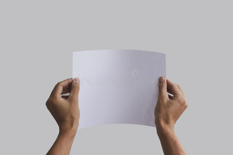Hand holding curved A4 paper in the hand. Leaflet presentation. Pamphlet hand man. Man show offset paper. Sheet template. Book in hands. Booklet folding design royalty free stock image