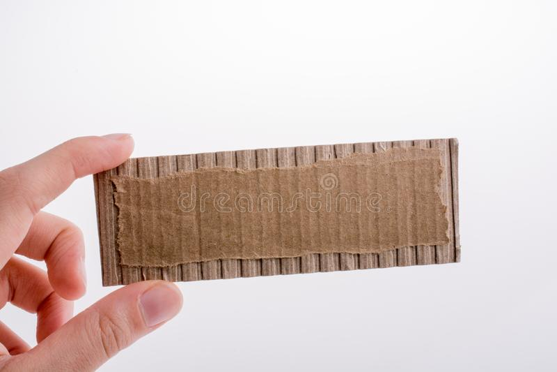 Hand holding a cut carton stock photo