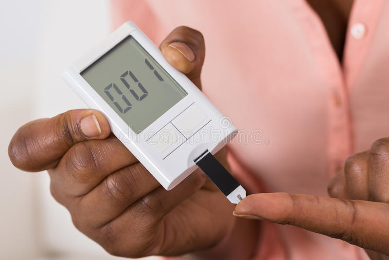 Hand Holding Device For Measuring Blood Sugar. Close-up Of Hand Holding Device For Measuring Blood Sugar stock image