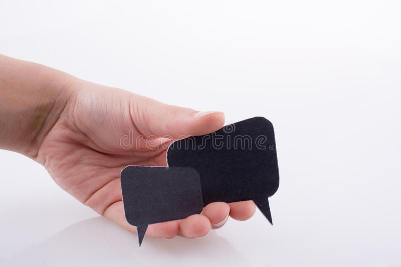 Hand holding dialogue boxes stock photo