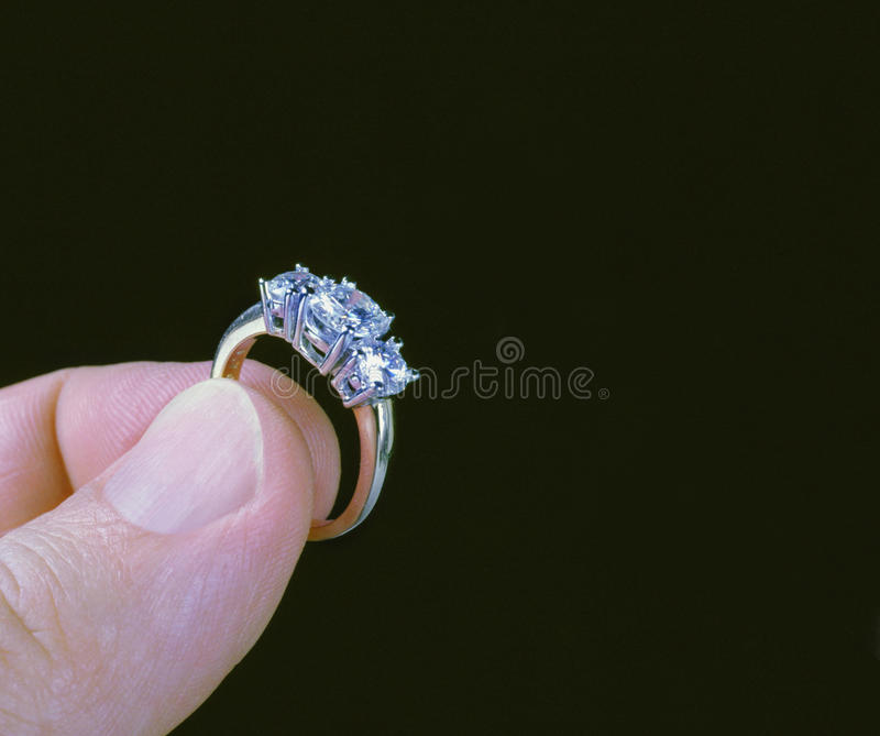 Hand holding diamond ring royalty free stock image