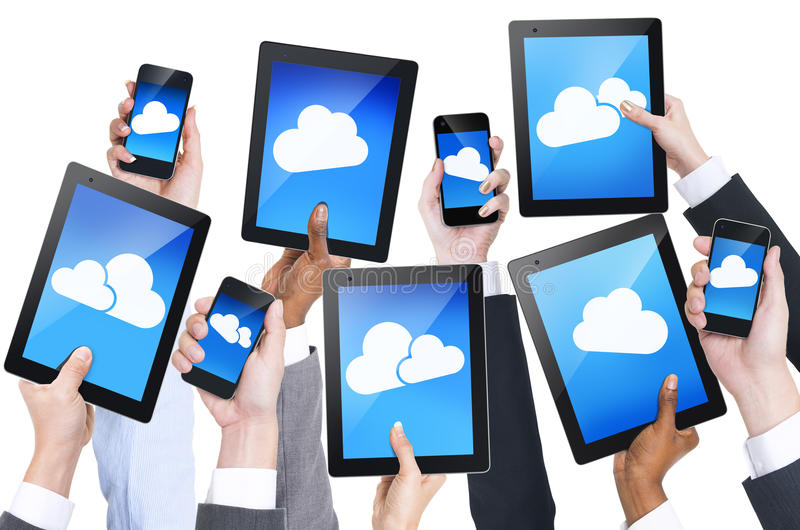 Hand Holding Digital Devices with Cloud Symbol. Group of Hand Holding Digital Devices with Cloud Symbol stock photography