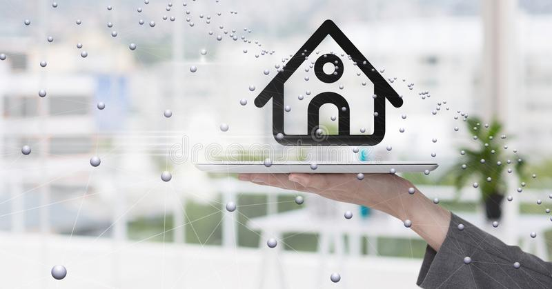 Hand holding digital tablet with home symbol and connecting dots. Digital composite of Hand holding digital tablet with home symbol and connecting dots stock photography