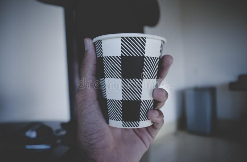 Hand holding disposable cup stock photo
