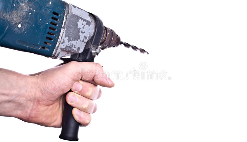 Hand holding drill royalty free stock photo