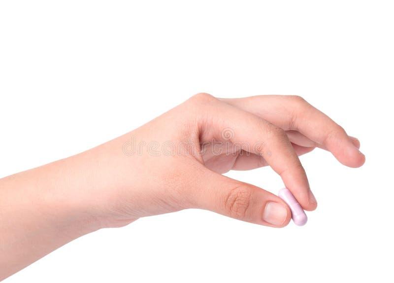 Hand holding Drug capsule on white royalty free stock photo