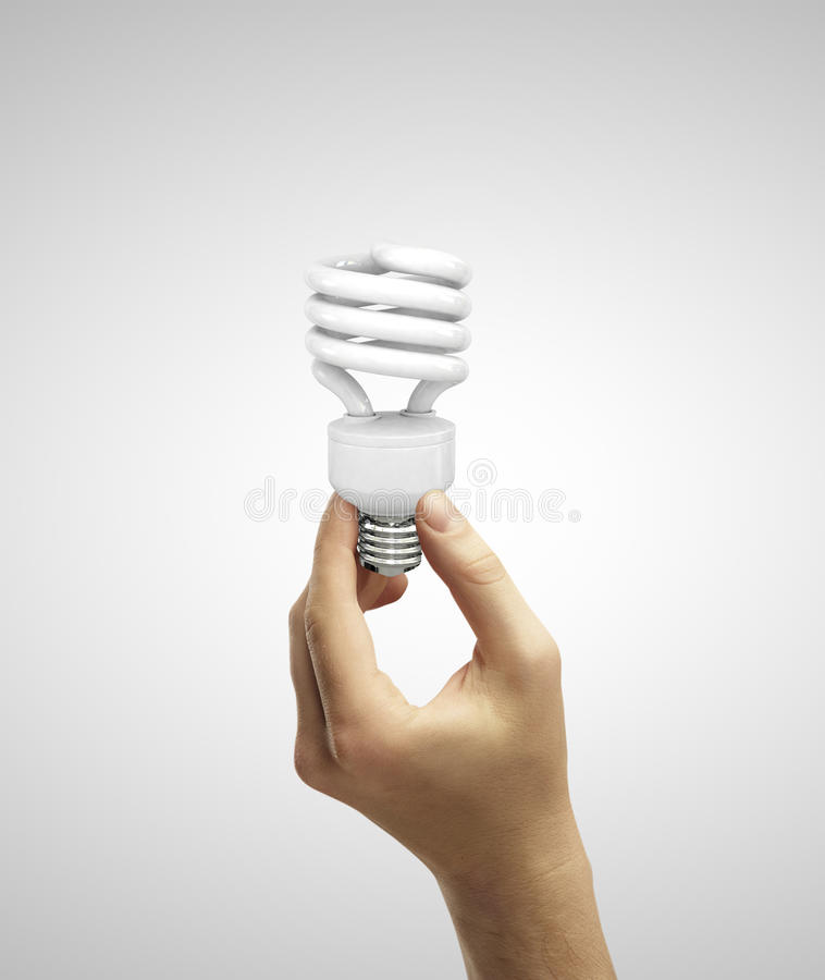 Hand holding e lamp royalty free stock images
