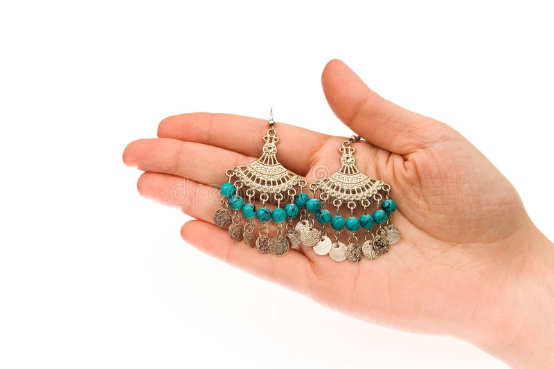 Hand holding earrings stock photos