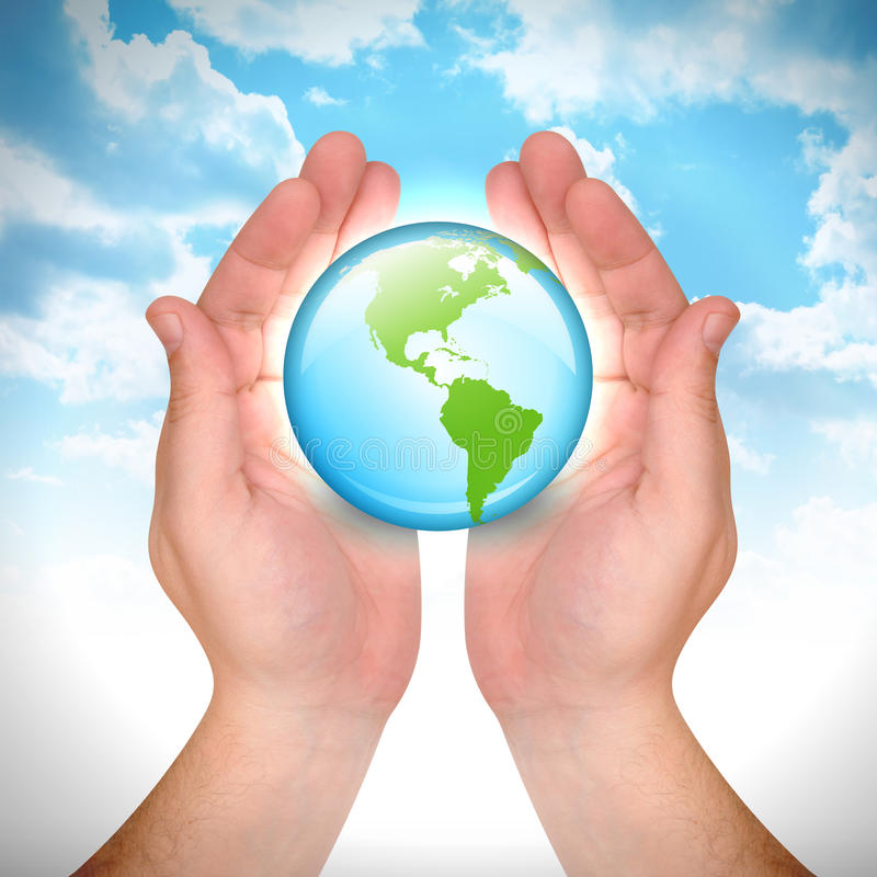 Hand Holding Earth Globe In Sky Stock Images