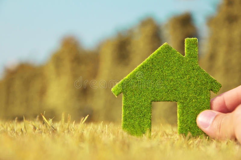 Hand holding eco house icon. Concept Save green planet royalty free stock images