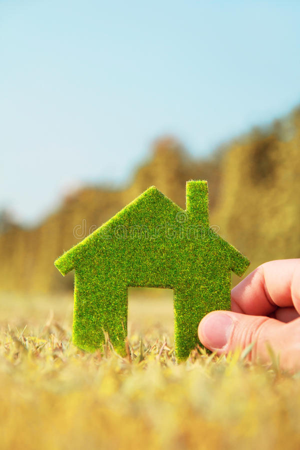 Hand holding eco house icon. Concept Save green planet royalty free stock photos