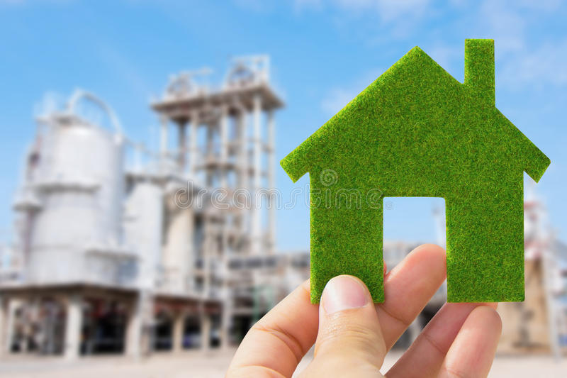 Hand holding eco house icon. Save energy concept royalty free stock photo