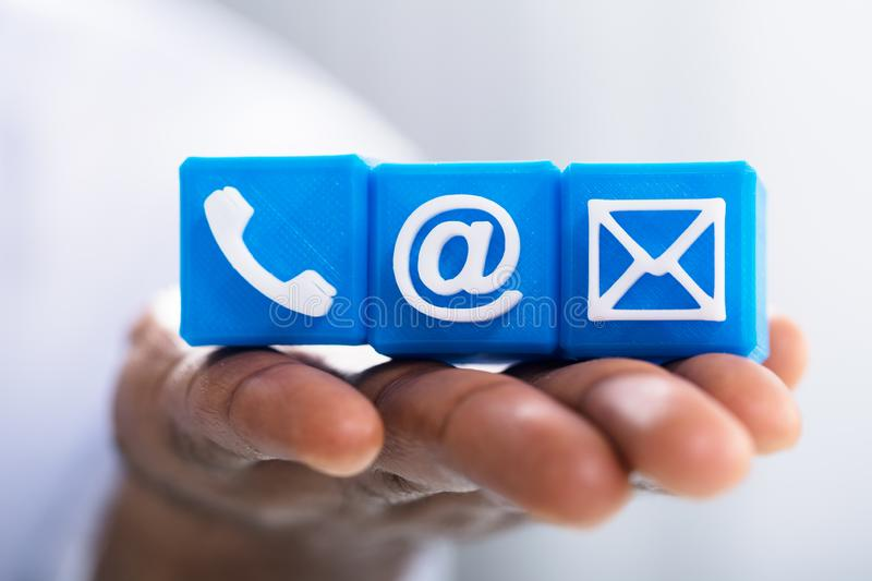 Hand Holding Email`s Icon Blocks royalty free stock photo