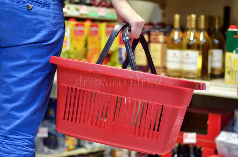 Hand holding empty shopping basket - Shopping concept royalty free stock photo