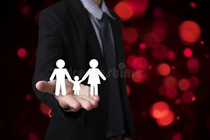 Hand holding family. concept assurance health-care. Insurance stock photo