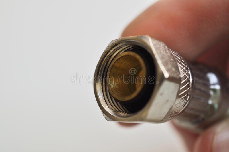 Hand holding faucet connector stock images