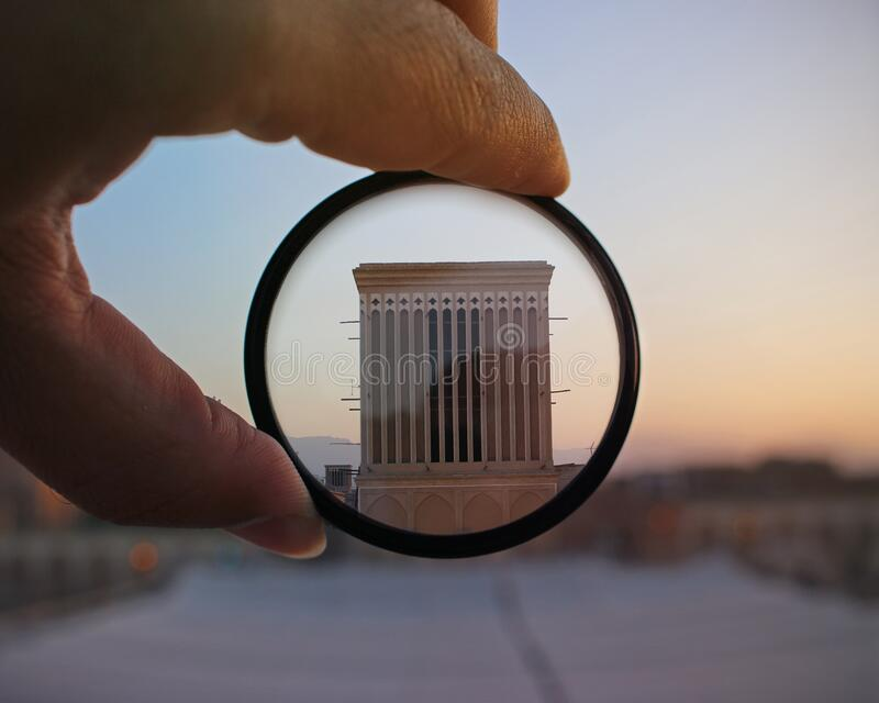 Hand holding filter on architecture royalty free stock images