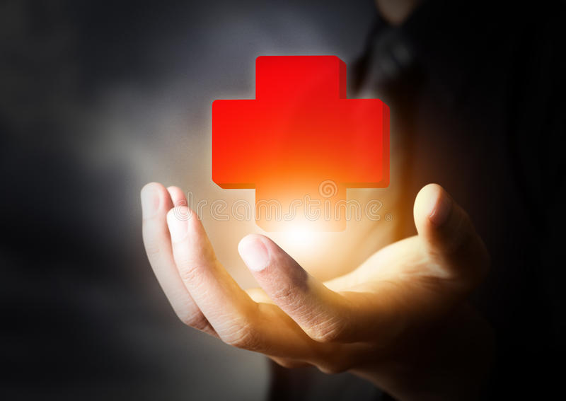 Hand holding First Aid icon royalty free stock photography