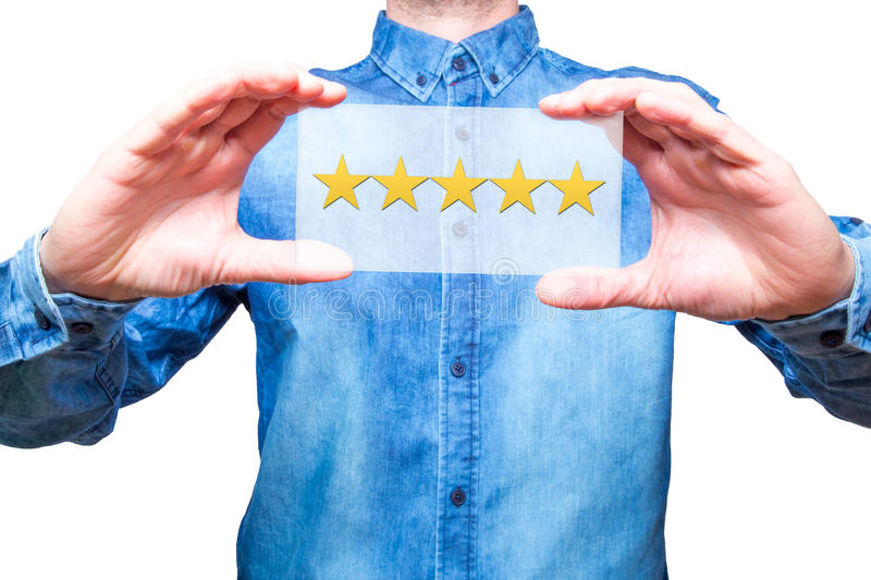 Hand holding five stars rating in his hands, representing business rating. Business concept. White background. Stock Photo stock photography