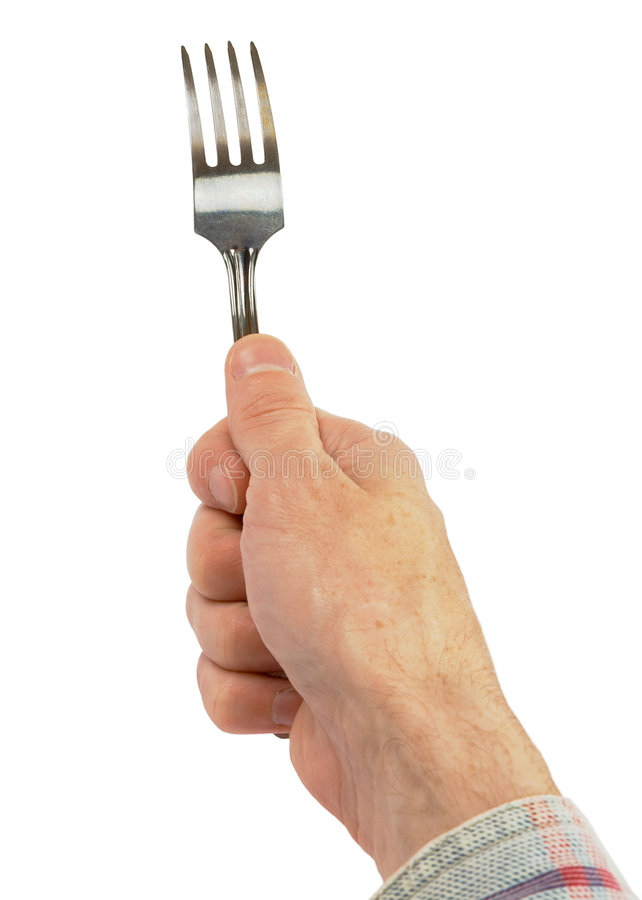 Hand holding a fork. Man's hand holding a fork on a white background royalty free stock image