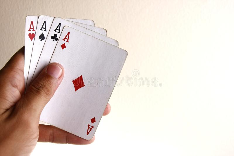 Hand holding Four aces of a playing card deck. Photo of a hand holding the Four aces of a playing card deck stock photo