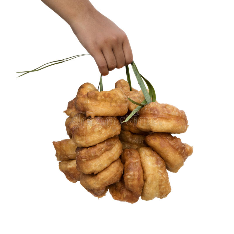 Hand holding fresh baked Moroccan donuts stock photos