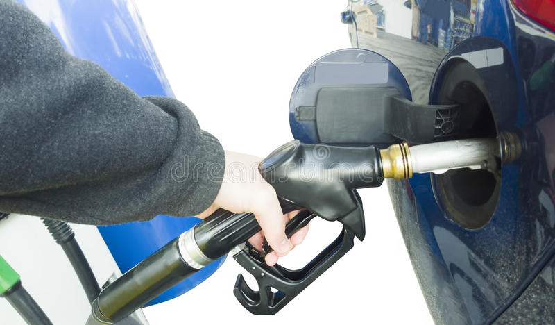 Hand holding fuel pump royalty free stock images