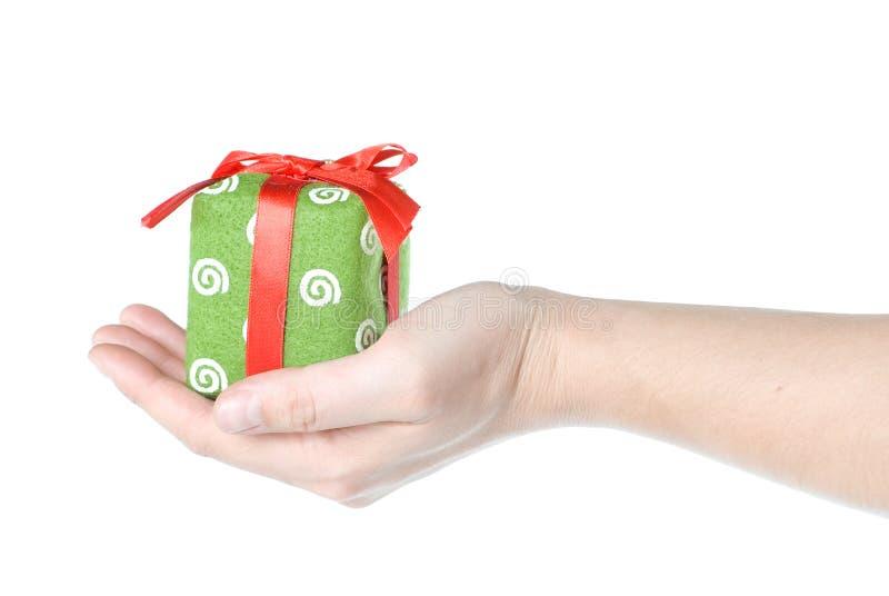 Hand holding gift stock photo