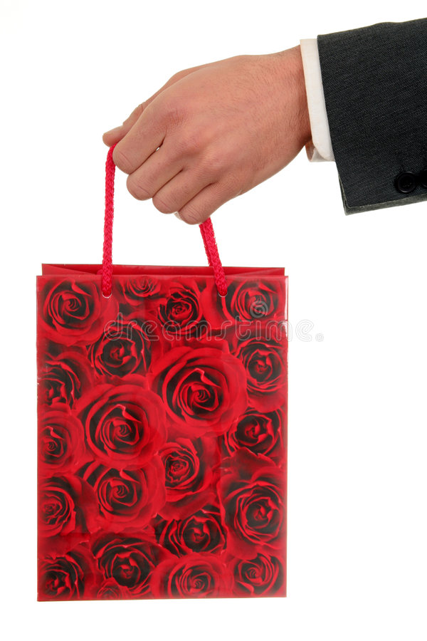 Hand Holding Gift Bag stock photo