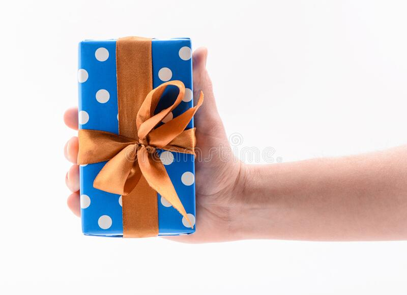 Hand holding a gift box, isolated on white stock photography