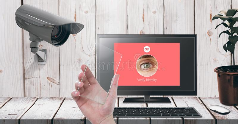 Hand holding glass screen with Security camera watching laptop identity App Interface. Digital composite of Hand holding glass screen with Security camera royalty free illustration