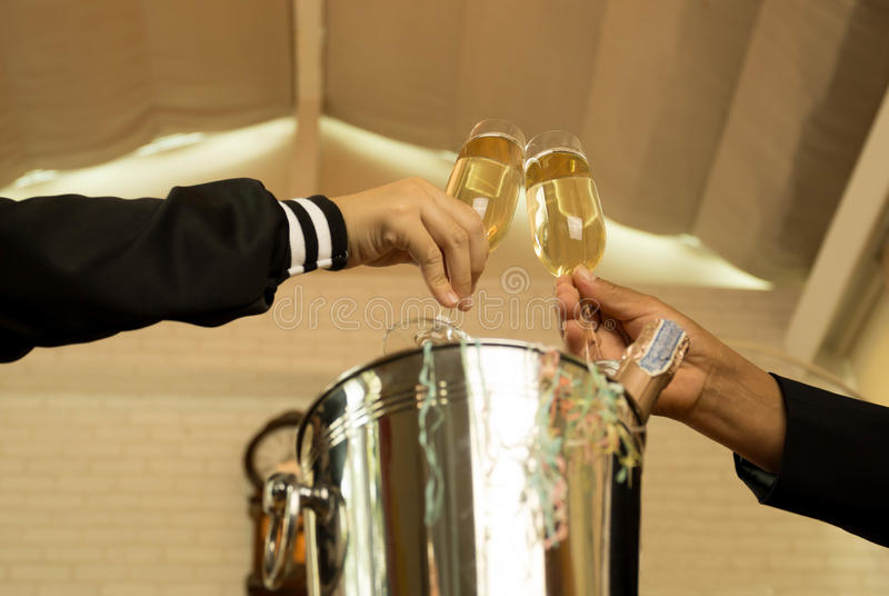 Hand holding glasses of champagne making a toast stock photos