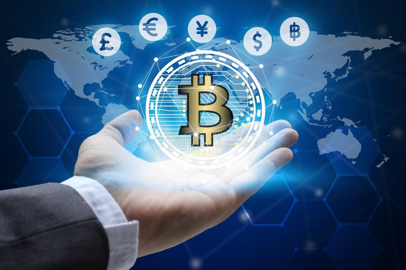 Hand holding global network using Currencies sign symbol interface of Bitcoin Fintech, virtual currency blockchain technology con. Cept, Investment Financial stock images