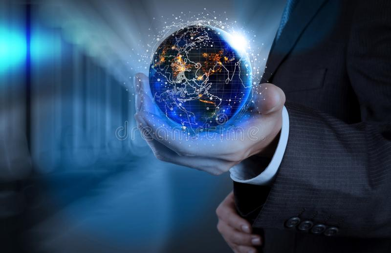 Hand holding Global world telecommunication network connected around planet Earth. For internet and worldwide communication technology fabout finance with royalty free stock image
