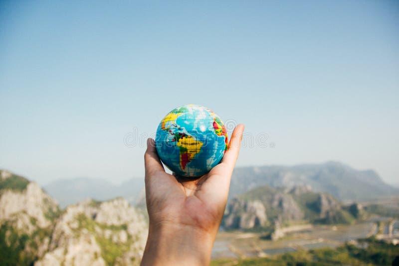 Hand holding globe royalty free stock images