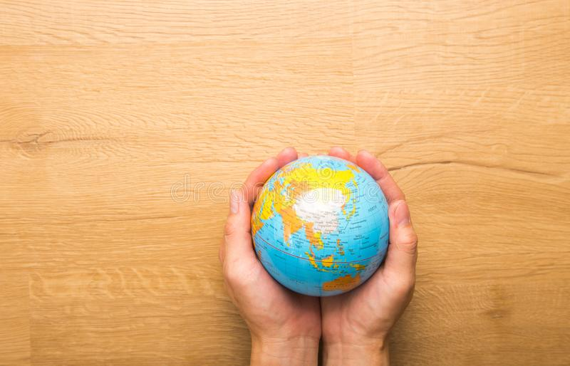 Hand holding a globe map royalty free stock images