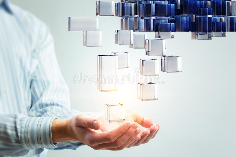 Hand holding glowing cubes. Innovation and creativity concept. royalty free stock image