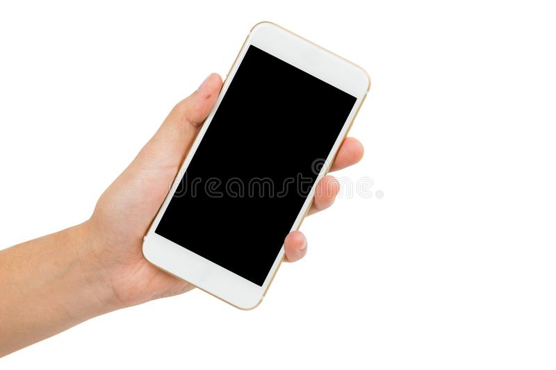 Hand holding gold smartphone on white background stock image