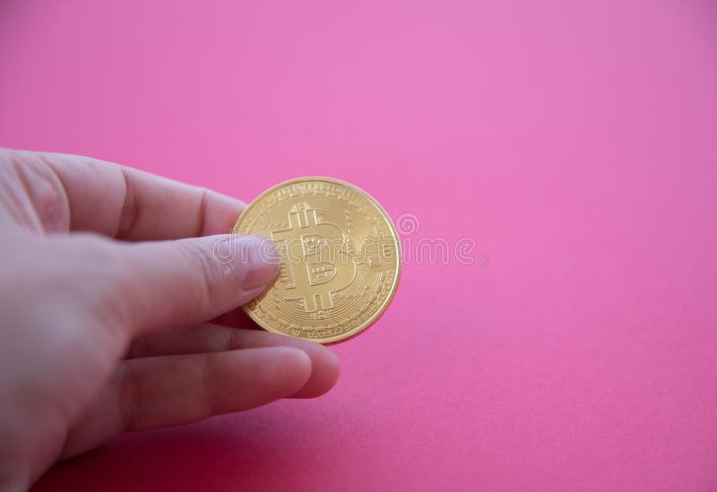 A hand holding golden Bitcoin stock images