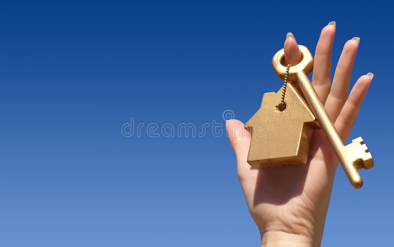 Hand holding golden key stock images