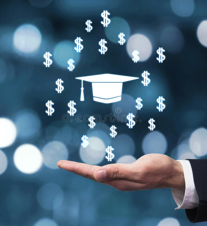 Hand holding Graduation cap with dollar signs royalty free stock photo