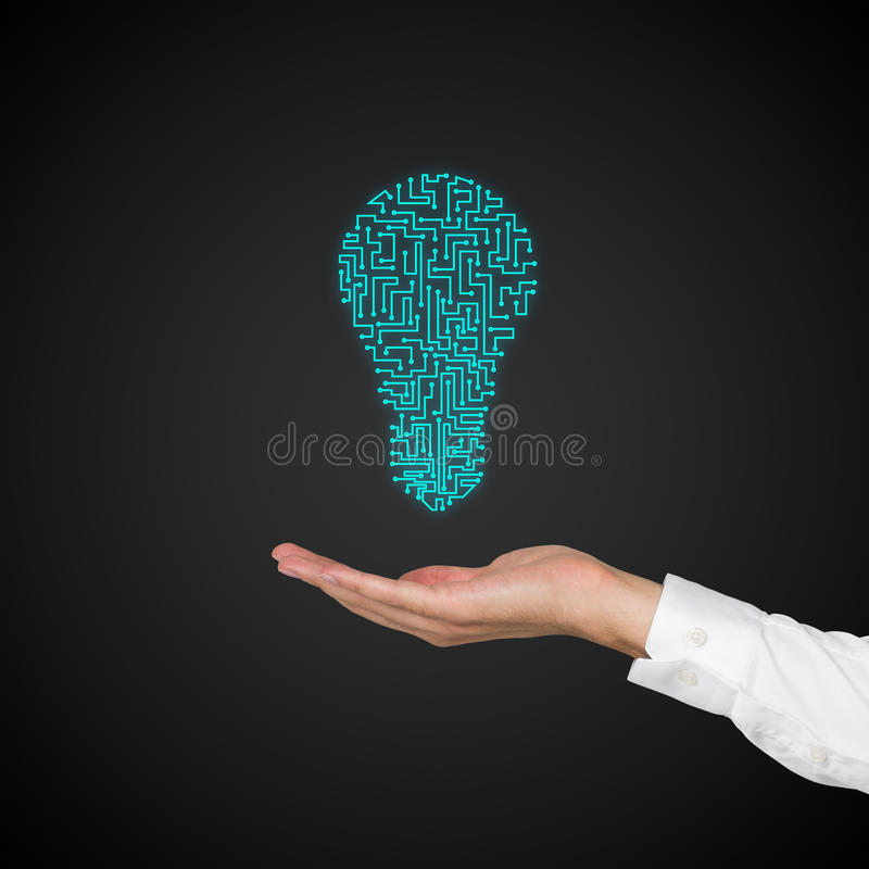 Hand holding green lamp stock photos