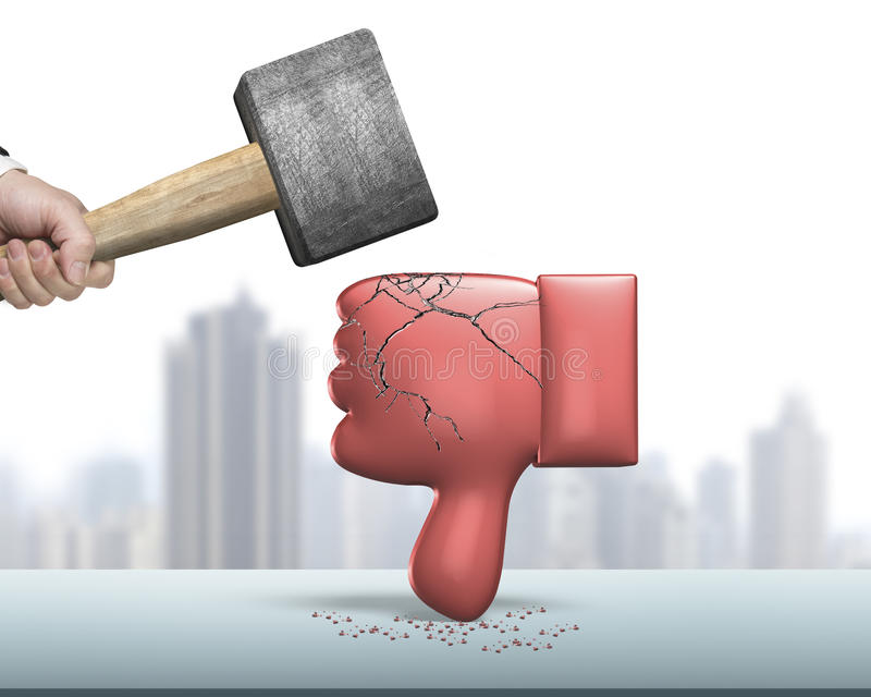 Hand holding hammer hitting red thumb down with cracks. Hand holding hammer hitting red 3D thumb down with cracks royalty free stock photo