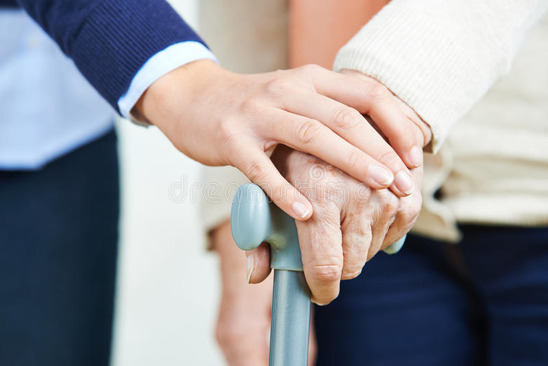 Hand holding hand of senior woman royalty free stock photo
