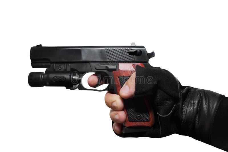 Hand holding a handgun profile. stock photos