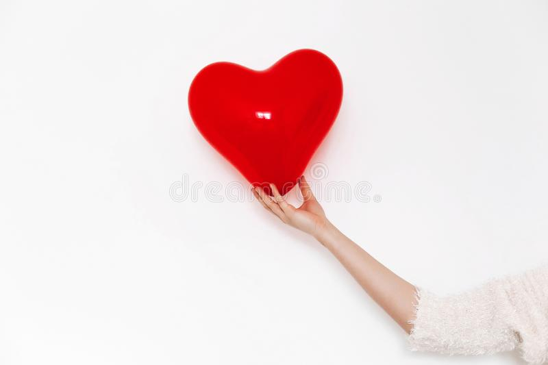 Hand holding heart. happy valentine`s day concept. red heart bal stock photo
