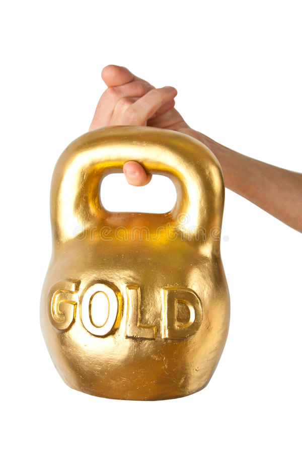 A hand holding heavy weight of gold royalty free stock image