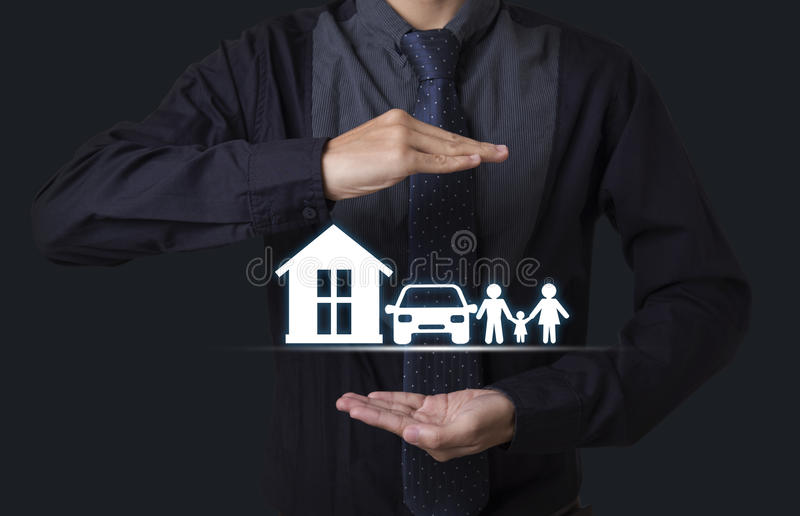 Hand holding home car family. concept assurance health-care. Insurance stock images